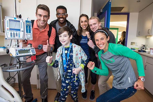 Elite runners visit patients in West Tower