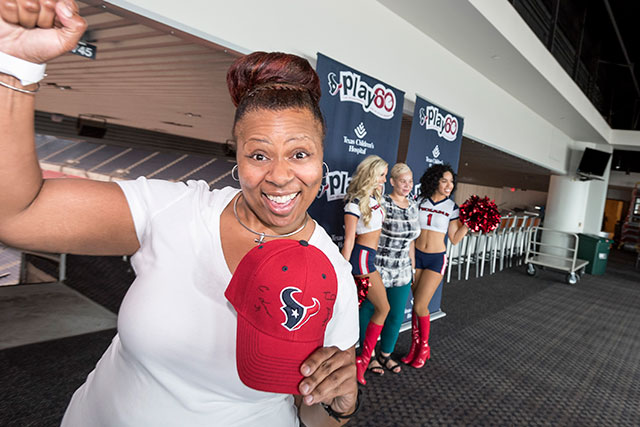Employees enjoy autograph, photograph session with Texans players