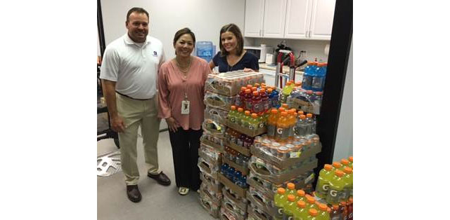 West Campus employees donate Gatorade to Camp Periwinkle
