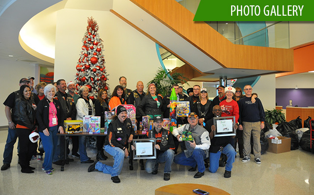 Motorcycle club members donate toys to West Campus