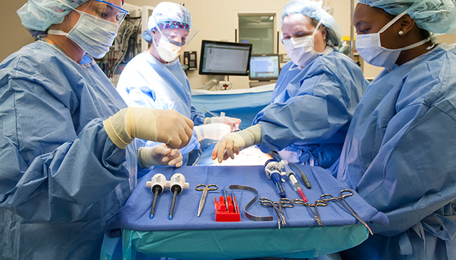 Sterile processing team prepares tools for surgery