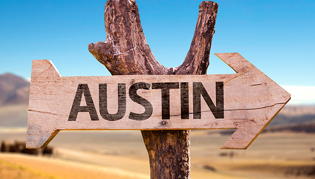 Employees learn more about new positions in Austin at town hall