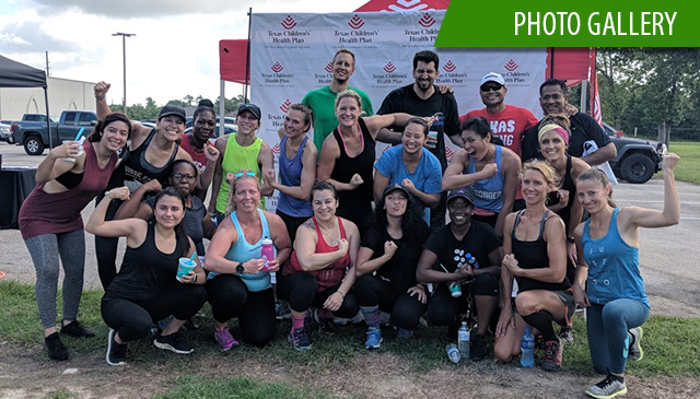 Employees sweat it out at free obstacle course race boot camp