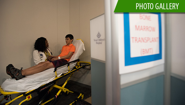 Employees and volunteers participate in radiation injury treatment exercise