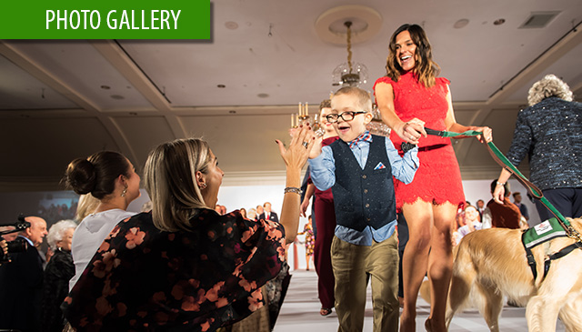 Pediatric cancer patients, survivors walk runway for Cancer Center